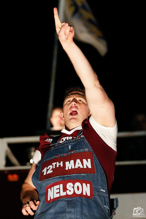 Nelson Ingram, head yell leader of the Fightin' Texas Aggie Yell Leaders, performs at the midnight Aggie Yell practice with thousands of Texas A&M Aggie fans at Stockyards Station in Fort Worth, Texas, on January 4, 2012.  (Stan Olszewski/The Dallas Morning News)