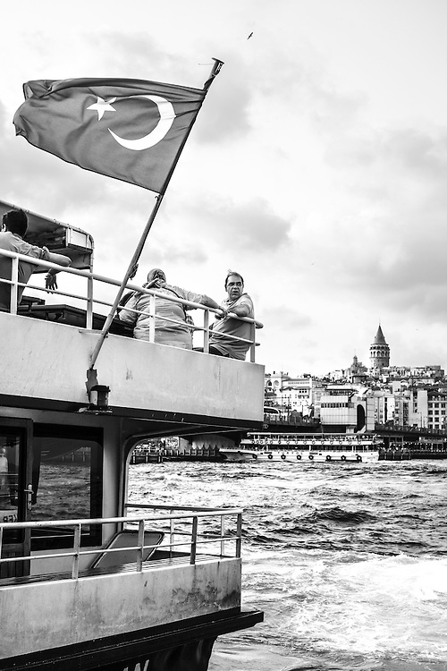 Tourists wait on a ferry in the Golden Horn at Eminonü, in Istanbul.