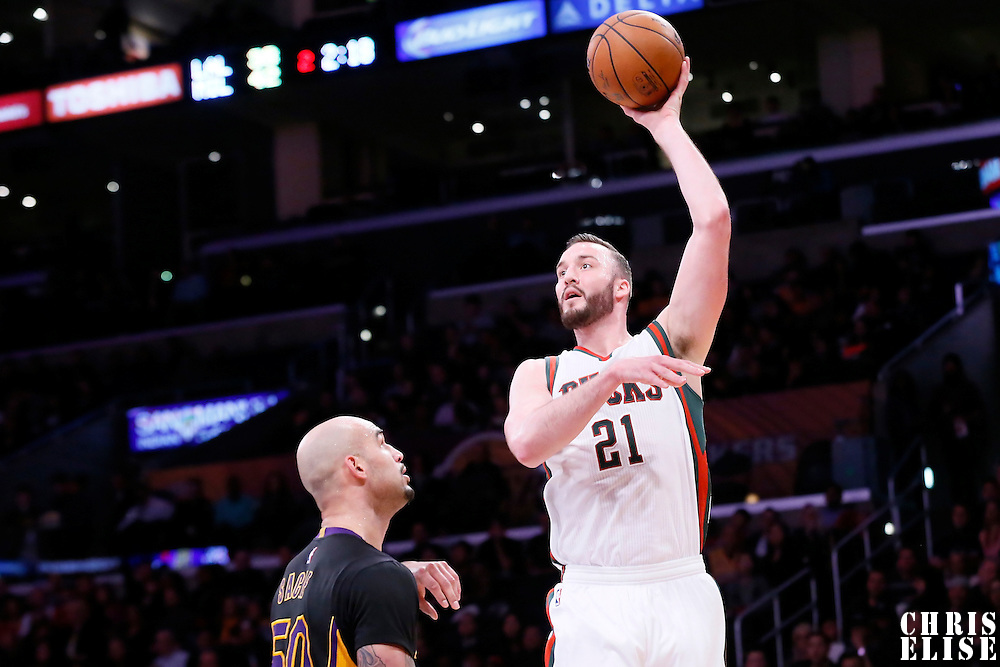 27 February 2015: Milwaukee Bucks center Miles Plumlee (21) goes for the jump hook over Los Angeles Lakers center Robert Sacre (50) during the Los Angeles Lakers 101-93 victory over the Milwaukee Bucks, at the Staples Center, Los Angeles, California, USA.