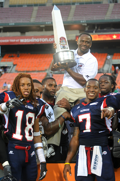 Washington DC--Members of the Howard University football team celebrate by lifting coach Gary Harrell on their shoulders after winning the AT&T Nation's Football Classic Saturday afternoon at RFK Stadium, beating Morehouse College 30-29 with a come from behind touchdown with less than a minute left in the game. (Photo by Alan Lessig)