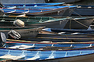 Colorful fishing boats float side by side at dock in Santa Rosalia, Baja California Sur, Mexico