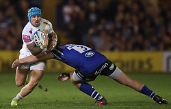 Exeter Chiefs' Jack Nowell gets past the tackle from Bath Rugby's Henry Thomas during the Gallagher Premiership match at the Recreation Ground, Bath.