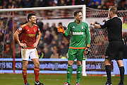 Nottingham Forest defender Eric Lichaj  and Nottingham Forest goalkeeper Dorus de Vries talk to referee Mark Brown during the Sky Bet Championship match between Nottingham Forest and Preston North End at the City Ground, Nottingham, England on 8 March 2016. Photo by Jon Hobley.