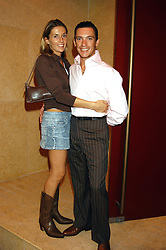 Jockey FRANKIE DETTORI and his wife CATHERINE at a party hosted by Frankie Dettori, Marco Pierre White and Edward Taylor to celebrate the launch of Frankie's Italian Bar & Grill at 3 Yeoman's Row, London SW3 on 2nd September 2004.