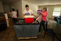 Raymond Townsend, Samuel Avard and Molly Simpson help Sarah Simpson move in to her apartment during Move In day at Lakes Region Community College on Sunday.  (Karen Bobotas/for the Laconia Daily Sun)