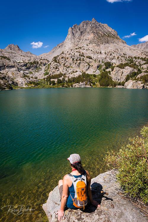 Hiker on the shore of Big Pine Lake #5, John Muir Wilderness, Sierra Nevada Mountains, California USA