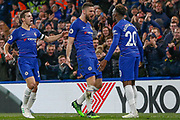 GOAL 1-0 Chelsea forward Olivier Giroud (18) scores and celebrates with teammates Chelsea defender Cesar Azpilicueta (28) and Chelsea midfielder Callum Hudson-Odoi (20) during the Premier League match between Chelsea and Brighton and Hove Albion at Stamford Bridge, London, England on 3 April 2019.