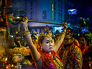 30 SEPTEMBER 2017 - BANGKOK, THAILAND: A woman holds up a trident during the Navratri parade in Bangkok. Navratri is a nine night (10 day) long Hindu celebration that marks the end of the monsoon and honors of the divine feminine Devi (Durga). The festival is celebrated differently in different parts of India, but the common theme is the battle and victory of Good over Evil based on a regionally famous epic or legend such as the Ramayana or the Devi Mahatmya. Navratri is celebrated throughout Southeast Asia in communities that have large Hindu population. Bangkok's celebration of Navratri was subdued this year because Thais are still mourning the death of Bhumibol Adulyadej, the Late King of Thailand, who died on October 13, 2016.      PHOTO BY JACK KURTZ
