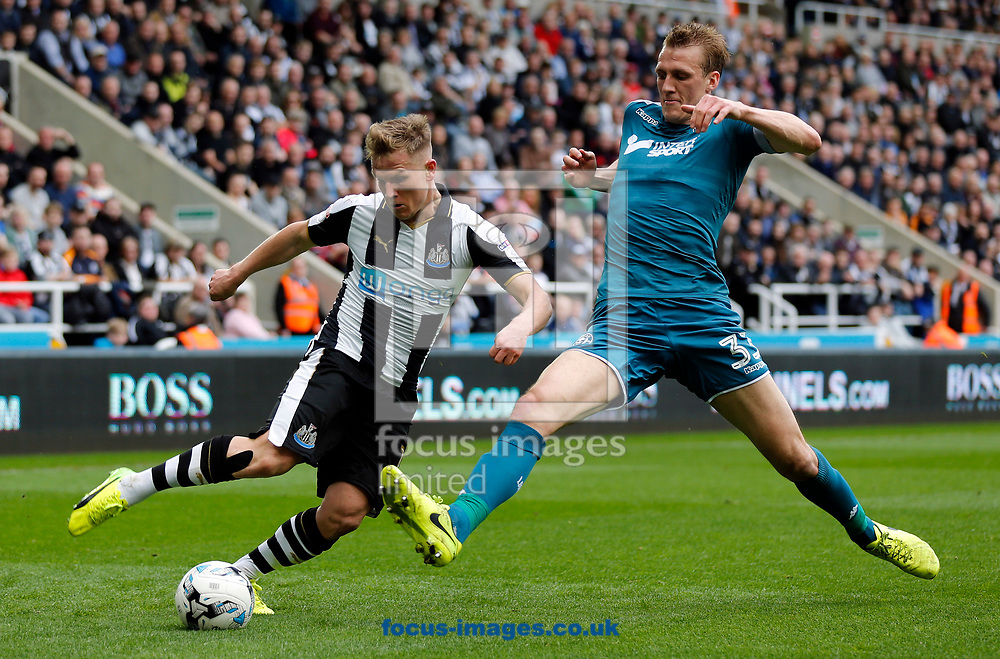 Matt Ritchie (l) of Newcastle United and Dan Burn of Wigan Athletic during the Sky Bet Championship match at St. James's Park, Newcastle<br /> Picture by Simon Moore/Focus Images Ltd 07807 671782<br /> 01/04/2017