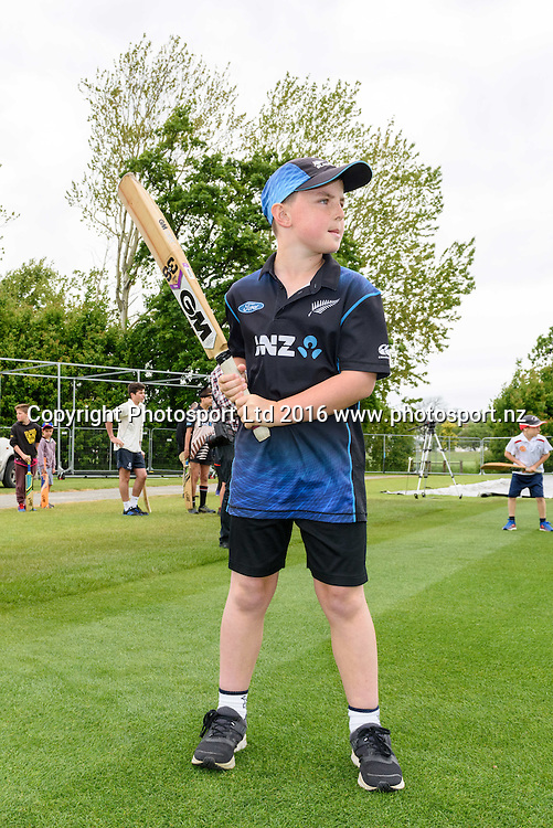 A young fan looks to bat during a Blackcaps Barbecue at Hagley Oval in Christchurch, New Zealand. 14 November 2016. Photo: Kai Schwoerer / www.photosport.nz