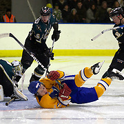 Southern Stampede player Tommy Mlivic crashes to the ice during a goalmouth scramble during the Southern Stampede V Dunedin Thunder National Ice Hockey League match at the Queenstown Ice Arena , South Island, New Zealand, 25th June 2011