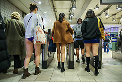 "© Licensed to London News Pictures. 13/01/2019. London, UK. Participants take part in 10th anniversary of 'No Trousers Tube Ride' event by arriving at Paddington Station.  The ""No Pants Subway Ride"" is an annual event staged by Improve Everywhere every January in New York City. The mission started as a small prank with seven guys and has grown into an international celebration of silliness, with dozens of cities including London around the world participating each year. Photo credit: Dinendra Haria/LNP"