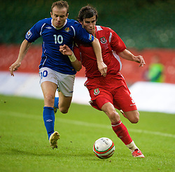 CARDIFF, WALES - Friday, September 5, 2008: Wales' Gareth Bale and Azerbaijan's Branimir Subasic during the opening 2010 FIFA World Cup South Africa Qualifying Group 4 match at the Millennium Stadium. (Photo by David Rawcliffe/Propaganda)