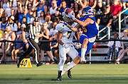 26 August 2016:  Will Watson (6) of the Thunderbirds catches a pass while being tackled by Jayden McKoy (7) of the Bisons in the Vancouver Island Thunder Bowl.  Action during a men's CIS exhibition Football game between the University of British Columbia Thunderbirds and the visiting University of Manitoba Bisons at Westhills Stadium in Langford, BC, Canada. Final Score: Manitoba 50 UBC 7 ****(Photo by Bob Frid/UBC Athletics  2016 - All Rights Reserved****)