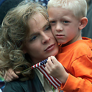 A mother holds her son close at a post-9/11 rally in Des Moines, Iowa.
