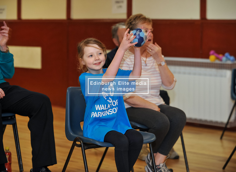 Pictured: Abby McConnell takes part in one of the excercises which involves catching a ball and throwing it back.<br /> <br /> A young fundraiser inspired by comedian Billy Connolly's battle with Parkinson's  prepares for a charity walk on April 15th - World Parkinson's Day - to raise funds for the charity. Abby McConnell (7) from Mount Florida met sufferers and took part in a seated exercise class specially designed for sufferers of the disease at Rutherglen West Parish Church in Glasgow.<br /> <br /> © Dave Johnston / EEm