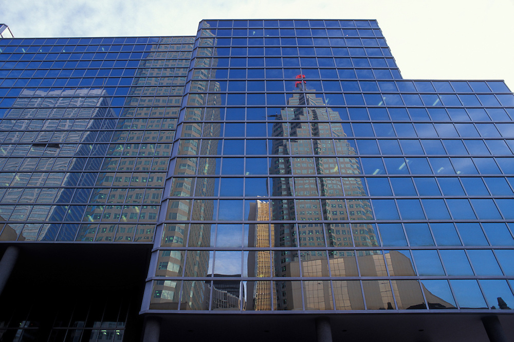 Canada, Ontario, Toronto, Reflection of CBC Building in the mirrored glass windows of Simco Place office building