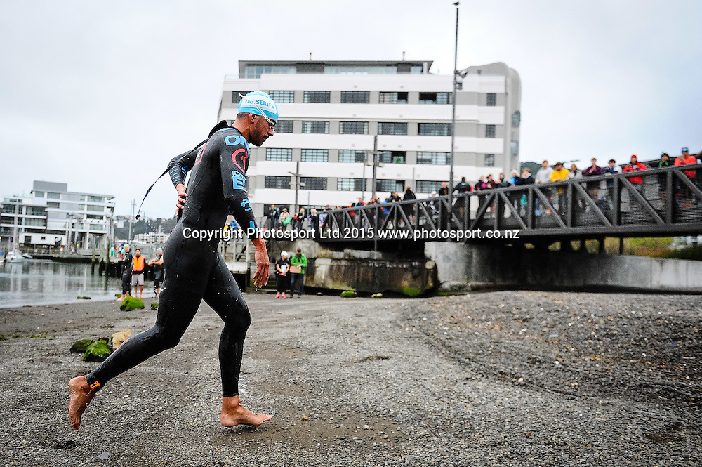 A competitor runs up the beach at the end of the swim leg at the Sovereign Tri Series, Waterfront, Wellington, New Zealand. Saturday 14 March 2015. Copyright Photo: Mark Tantrum/www.Photosport.co.nz