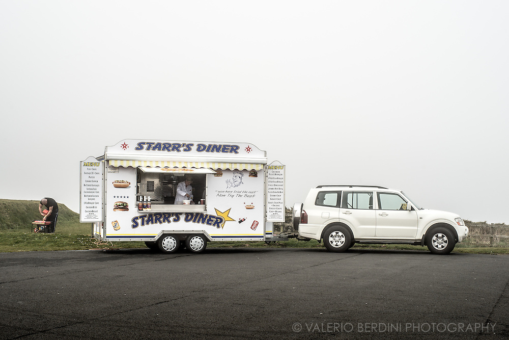 A van selling food parked in a resting area along a coastal road in the north of Northern Ireland.
