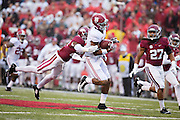 FAYETTEVILLE, AR - OCTOBER 11:  O.J. Howard #88 of the Alabama Crimson Tide runs the ball and avoids the tackle of Rohan Gaines #26 of the Arkansas Razorbacks at Razorback Stadium on October 11, 2014 in Fayetteville, Arkansas.  The Crimson Tide defeated the Razorbacks 14-13.  (Photo by Wesley Hitt/Getty Images) *** Local Caption *** O.J. Howard; Rohan Gaines
