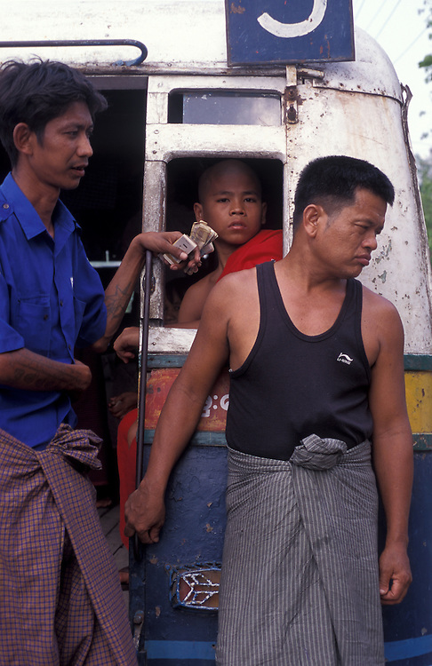 A novice monk rides the bus in Yangon.