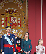 King Felipe VI of Spain, Queen Letizia of Spain and Princess Leonor attended the Military Parade during the Spanish National Day on October 12, 2014 in Madrid, Spain
