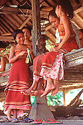 INDONESIA, BALI, VILLAGE LIFE making temple offerings in Tenganan