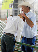 After the showmanship event, Carter Watsabaugh gets a good head-rub of approval from his dad Justin Watsabaugh.