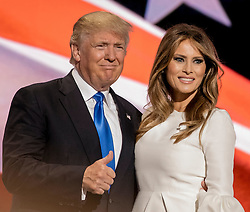 July 18, 2016 - Cleveland, Ohio, U.S - Republican U.S. presidential candidate DONALD TRUMP and his wife MELANIA TRUMP at the podium after she concluded her remarks at the Republican National Convention. (Credit Image: © Mark Reinstein via ZUMA Wire)