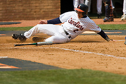 Virginia Cavaliers infielder Greg Miclat (2) beats a throw to home to score a run against Duke.  The Virginia Cavaliers Baseball team defeated the Duke Blue Devils 8-1 in the final game of a three game series at Davenport Field in Charlottesville, VA on April 8, 2007. The win secured a 2-1 series victory over the Blue Devils.