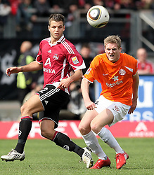 03.04.2010, easyCredit Stadion, Nuernberg, GER, 1. FBL, 1 FC Nuernberg vs 1 FSV Mainz 05, im Bild: .Zweikampf zwischen Dennis Diekmeier (Nuernberg #2) und Andre Schuerrle (Mainz #14).EXPA Pictures © 2010, PhotoCredit: EXPA/ nph/  news / SPORTIDA PHOTO AGENCY
