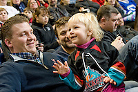 KELOWNA, CANADA, FEBRUARY 15: A Kelowna Rockets fan high fives Rocky the Racoon at the Kelowna Rockets on February 15, 2012 at Prospera Place in Kelowna, British Columbia, Canada (Photo by Marissa Baecker/Shoot the Breeze) *** Local Caption ***
