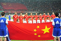 Players of China pose before a friendly football match against Paraguay in Changsha city, central China's Hunan province, 14 October 2014.<br /> <br /> Paraguay's dismal run of form continued as they suffered a 2-1 friendly defeat to China on Tuesday (14 October 2014). The South American nation, who came into the game having won two of their previous 13 fixtures, fell short in their bid to pull off a late comeback at Changsha's Helong Stadium. In contrast to their opponents, China have now lost just two of their last 16 matches as they continue to build towards next year's AFC Asian Cup in Australia.