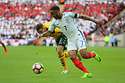 Raheem Sterling of England setting up the first goal during the FIFA World Cup Qualifier group stage match between England and Lithuania at Wembley Stadium, London, England on 26 March 2017. Photo by Matthew Redman.