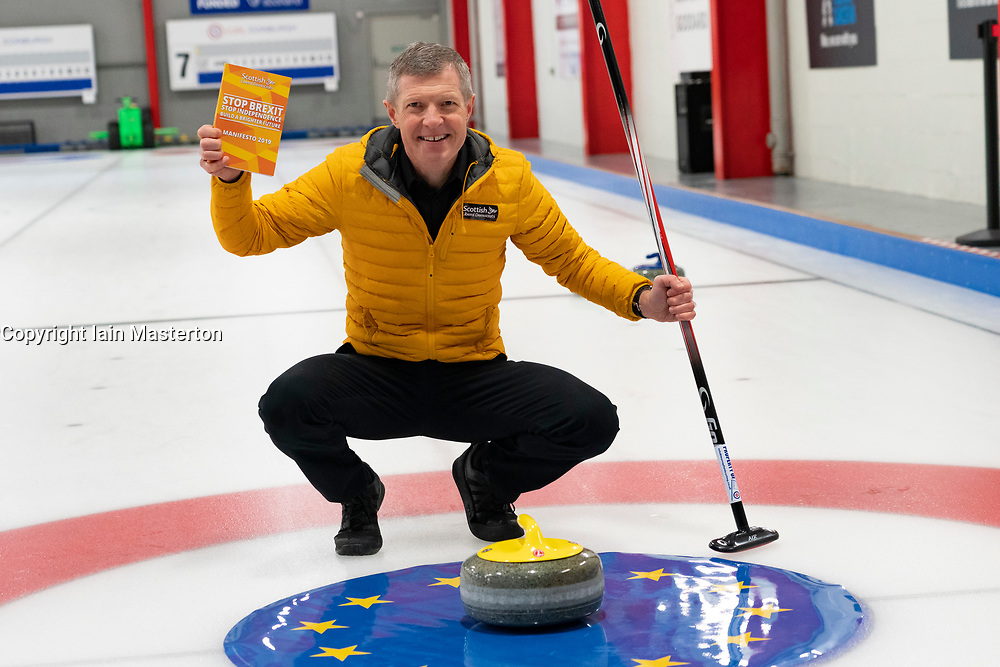 Edinburgh, Scotland, UK. 29th November 2019. Scottish Liberal Democrat Leader Willie Rennie was joined by Liberal Democrat MP candidates to launch the party's General Election manifesto at the Edinburgh Curling Rink. Pictured; Willie Rennie with manifesto. Iain Masterton/Alamy Live News.