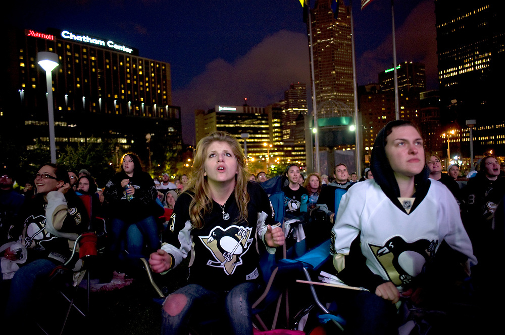 Ashley Krysinski, 20, (left) of Munhall, anxiously watches Pittsburgh Penguins compete against the Montreal Canadiens on a big screen outside Mellon Arena in Pittsburgh.  The Canadiens won the game 5-2 which ended the Penquins chance for another Stanley Cup. This was the last Penguins game at Mellon Arena.  Krysinski was joined by her friend Savannah David, 21, (right) of West Mifflin.