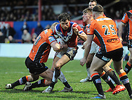Scott Grix of Wakefield Trinity Wildcats is stopped by the Castleford Tigers defence during the Pre-season Friendly match at Belle Vue, Wakefield<br /> Picture by Richard Land/Focus Images Ltd +44 7713 507003<br /> 15/01/2017