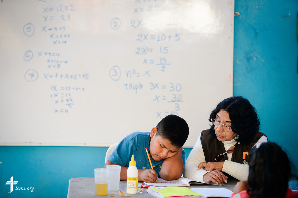 A teacher works with a young student at Castillo Fuerte in San Juan de Lurigancho on Tuesday Nov. 7 2017, in Peru.  LCMS Communications/Erik M. Lunsford