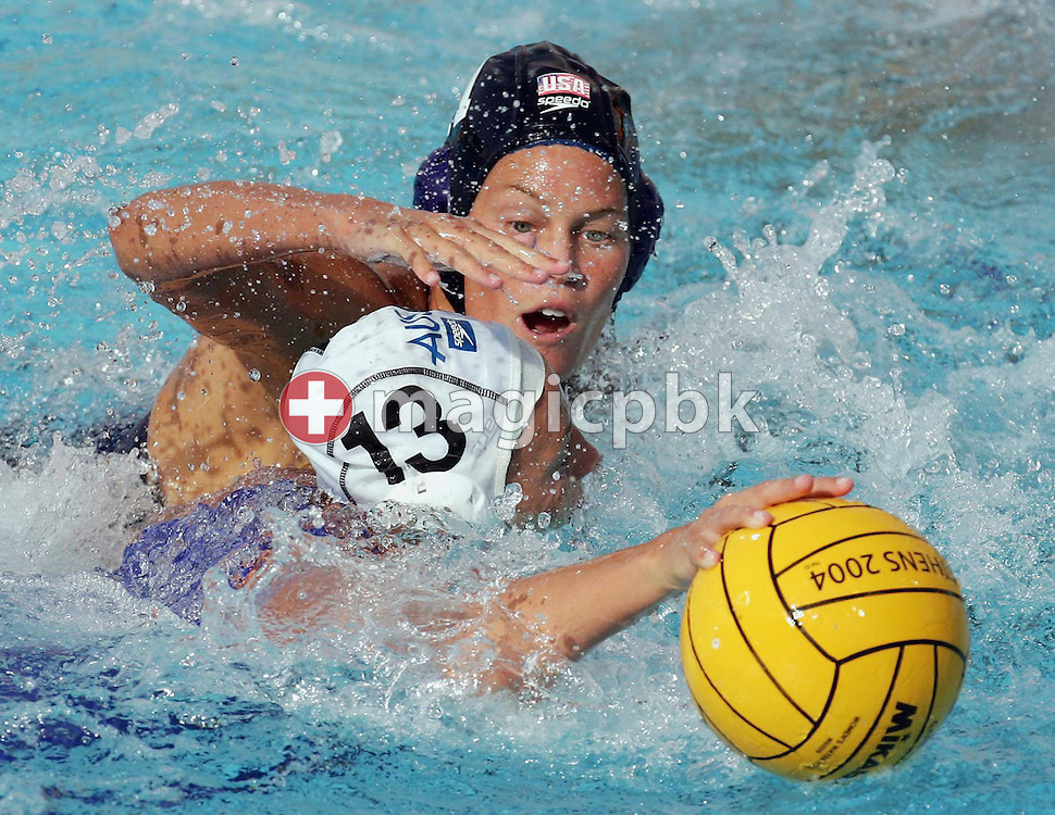An unidentified US player goes after the ball as Australian player Melissa Rippon (13) keeps it away during the  United States vs Australia bronze medal match in the Women's Water Polol at theOlympicv Aquatic Centre in Athens Thursday 26 August 2004.  The US won 6 to 5 to win the bronze. (Photo by Patrick B. Kraemer / MAGICPBK)