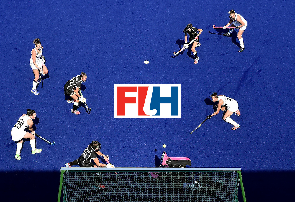Germany's goalkeeper Kristina Reynolds (bottom R) stops a a shot at goal from New Zealand's Petrea Webster (R) during the women's Bronze medal hockey match between Germany and New Zealand of the Rio 2016 Olympic Games at the Olympic Hockey Centre in Rio de Janeiro on August 19, 2016. / AFP / MANAN VATSYAYANA        (Photo credit should read MANAN VATSYAYANA/AFP/Getty Images)
