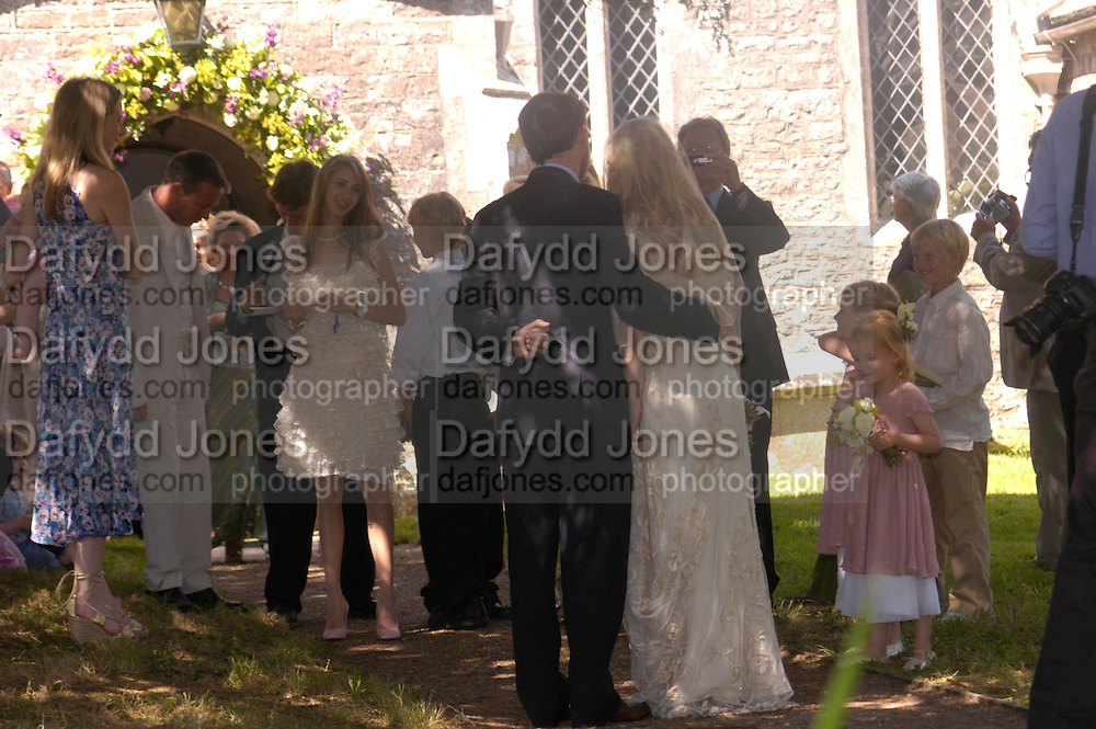 Ella Harris facing the The Bride and Groom.. Marriage of Emilia Fox to Jared Harris. St. Michael's and All Angels. Steeple. Nr. Wareham. Dorset. 16 July 2005. ONE TIME USE ONLY - DO NOT ARCHIVE  © Copyright Photograph by Dafydd Jones 66 Stockwell Park Rd. London SW9 0DA Tel 020 7733 0108 www.dafjones.com