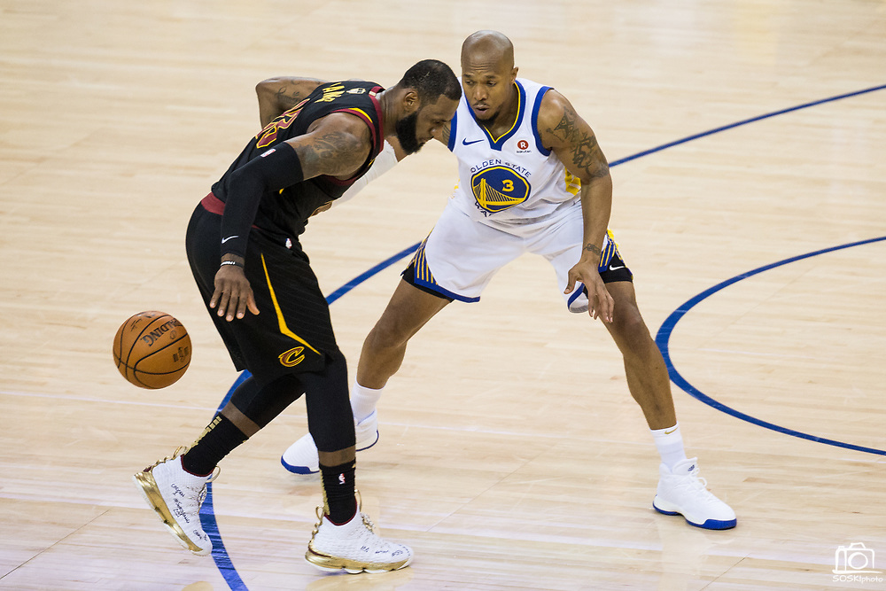 Golden State Warriors forward David West (3) defends Cleveland Cavaliers forward LeBron James (23) during Game 1 of the NBA Finals at Oracle Arena in Oakland, Calif., on May 31, 2018. (Stan Olszewski/Special to S.F. Examiner)