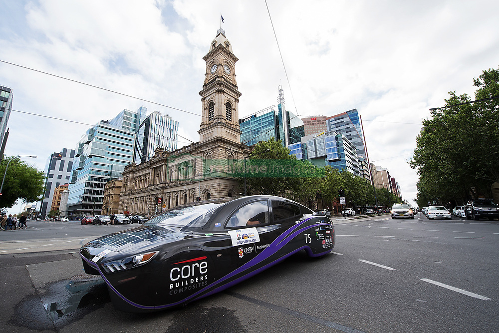 ADELAIDE, AUSTRALIA - OCTOBER 13: UNSW Solar Racing Team vehicle 'Sunswift Violet' from Australia passes the Adelaide Town Hall on Day 6 of the 2017 Bridgestone World Solar Challenge at Victoria Square on October 13, 2017 in Adelaide, Australia. Teams from across the globe are competing in the 2017 World Solar Challenge - a 3000 km solar-powered vehicle race between Darwin and Adelaide. The race begins on October 8th with the first car expected to cross the finish line on October 11th.  (Photo by Daniel Kalisz/Getty Images for SATC) (Credit Image: © 2017 Bridgestone World Solar C/Xinhua via ZUMA Wire)