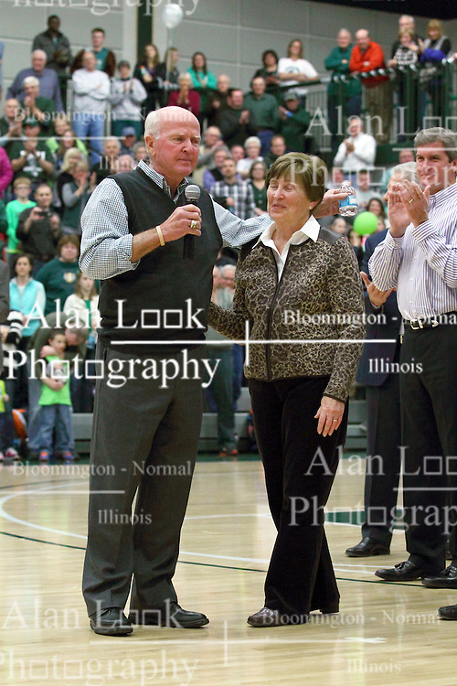 21 February 2015:  Dennie Bridges is joined by his wife Rita on the court.  At half time of an NCAA D# CCIW men's basketball game between the Illinois Wesleyan Titans in Shirk Center, Bloomington IL the floor was named in honor of retiring Dennie Bridges.  Dennie Bridges has been on the job at IWU for 51 years as a basketball coach, then athletic director.  Dennie is the 2nd winningest D3 coach by wins behind only Dick Saurs.  Dennie took the Titans to the D3 NCAA tournament 14 times in 18 season. He had a league record of 421-129 in 17 seasons.  Jack Sikma was a part of Dennie's 1973 recruiting class.  Sikma later played for the Milwaukee Bucks and Seattle Supersonics in the NBA.  IWU President Richard Wilson presided over the ceremony.
