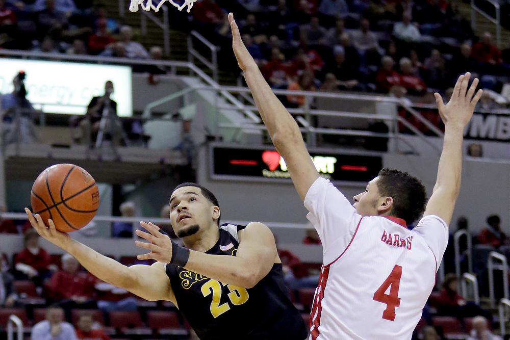 Wichita State guard Fred VanVleet (23) shoots against Bradley forward Auston Barnes (4) during the second half of an NCAA college basketball game Wednesday, Feb. 4, 2015, in Peoria, Ill. Wichita State won the game 62-59. (AP Photo/ Stephen Haas)
