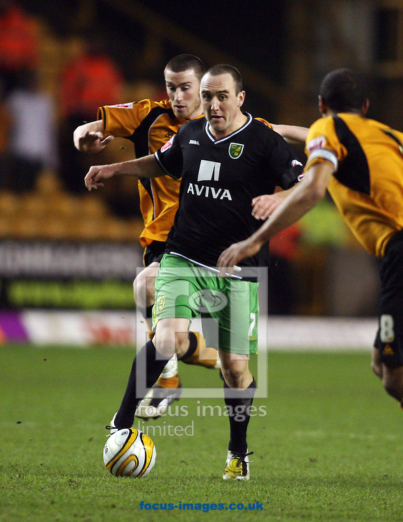 Wolverhampton - Tuesday February 3rd, 2009: Norwich City's Lee Croft goes past David Jones of Wolverhampton Wanderers during the Coca Cola Championship match at Molineaux, Wolverhampton. (Pic by Chris Ratcliffe/Focus Images)