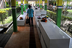 A man walks past coffins of victims of AirAsia Flight QZ8501 at a hospital in Pangkalan Bun, Indonesia. Jan. 4, 2015. An Indonesian pilot taking part in the multinational search operation said here on Sunday that three more bodies were found in AirAsia crash site off Borneo coast. EXPA Pictures © 2015, PhotoCredit: EXPA/ Photoshot/ Agung Kuncahya B.<br /> <br /> *****ATTENTION - for AUT, SLO, CRO, SRB, BIH, MAZ only*****