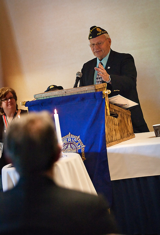 Mayor of Post Falls and American Legion Member grants a warm welcome to Governor C.L. Butch Otter, front left, during the American Legion's 92nd annual American Legion Convention at the Red Lion Templin Hotel on Friday.