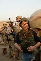 Al Franken with soldiers at Abu Ghraib prison during a USO tour...photograph by Owen Franken......... Al Franken