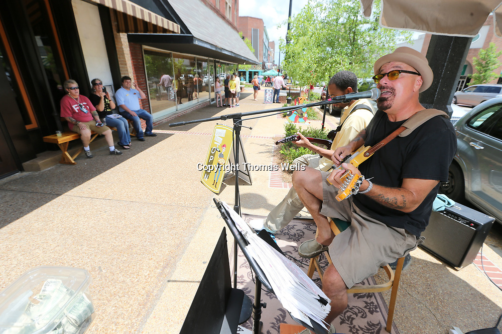 Anthony Zappa performs along the sidewalk in front of Vanellli's Bistro on West Main Street as part of Saturday's live music venues throughout Tupelo.